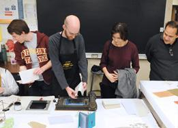 Arizona state students working with printmaking tools