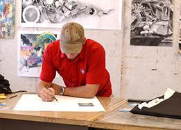 Art student working on a drawing project