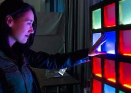 Student is touching colorful lights
