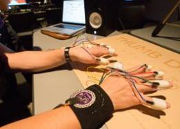 Digital culture lab, student's hands with cables and technology