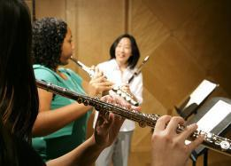 School of Music faculty teaches students how to play the flute