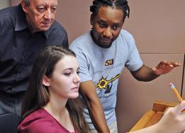Students and faculty studying music