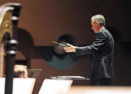 Music conductor holding his baton