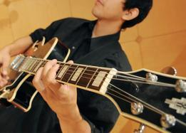 ASU school of music student playing the guitar