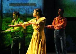 Students performing, woman in a yellow dress
