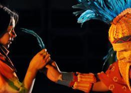 Students performing, person with feathers on his head