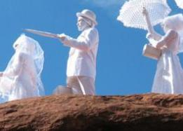 Performance, people in white costumes