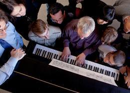 Students learning how to play the piano