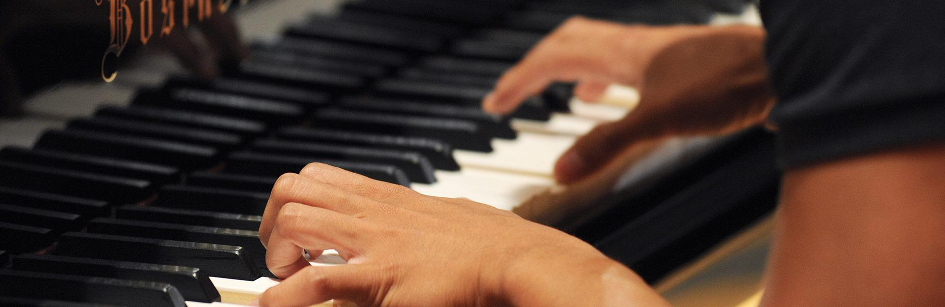 School of music student playing piano