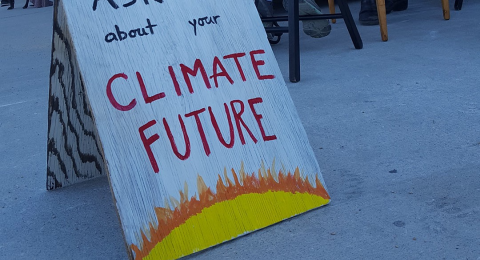 "A poster that says ""ASK ME about your Climate Future"""