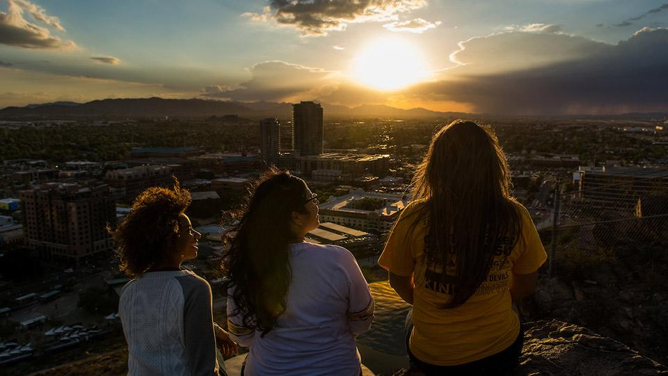 ASU students viewing the sunset at A-Mountain