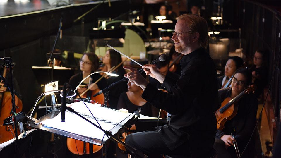 Directing an orchestra at ASU event