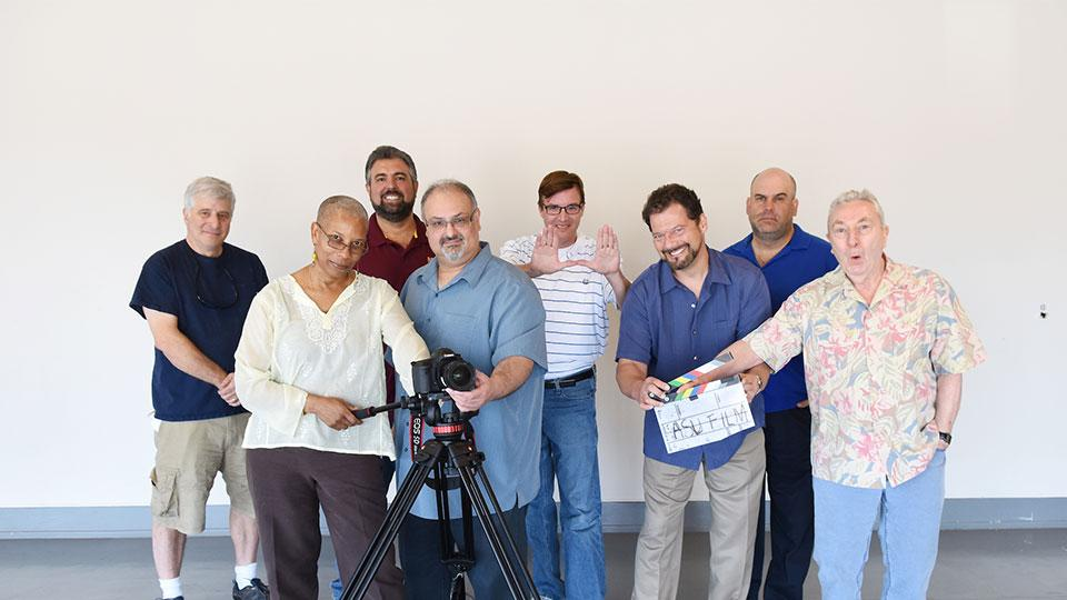 Faculty and staff with a camera and ASU film