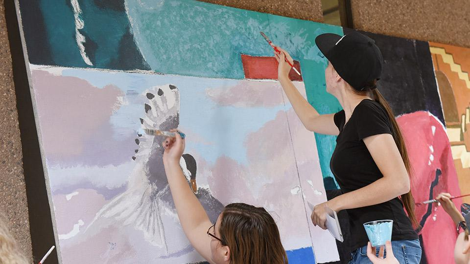 Herberger Institute Day - Woman painting a mural