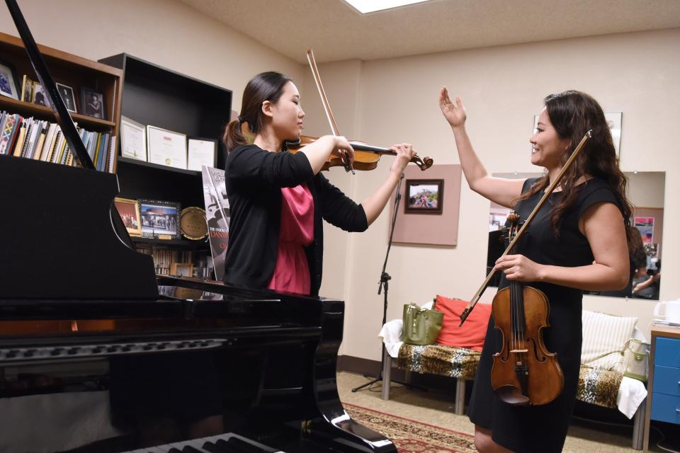 ASU Music faculty member working with student