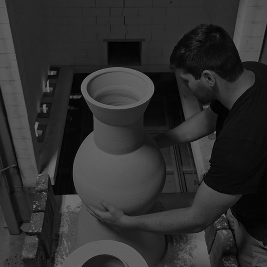 Pottery/ceramics student at kiln