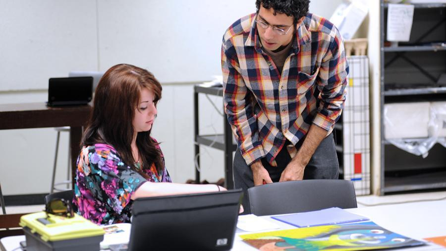 Young man and woman engage in discussion during workshop