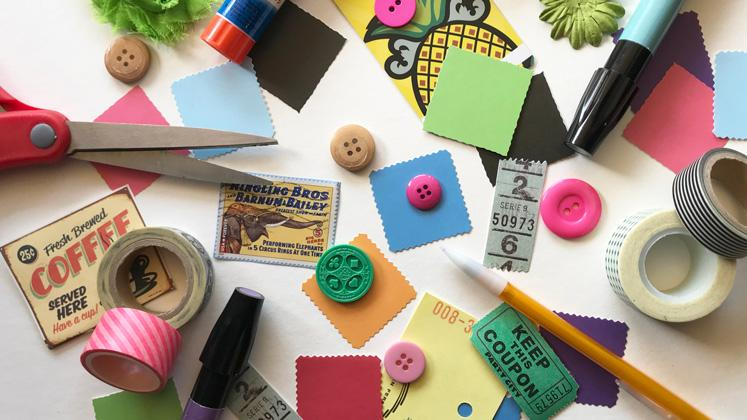 paper, fabric buttons, scissors, and other various crafting supplies