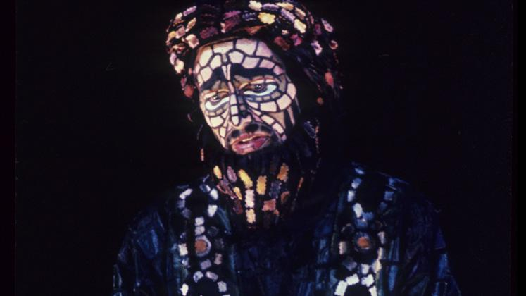 actor in mosaic costume and face paint