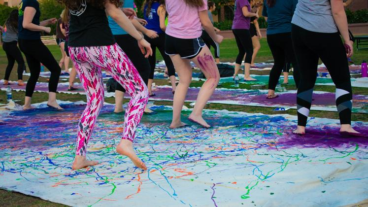 students dancing in paint