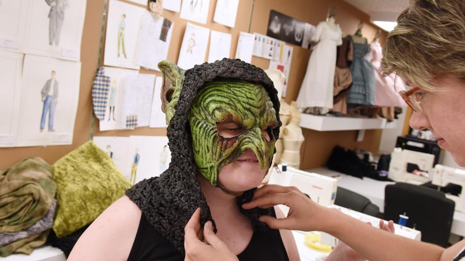 theatre student getting ghoulish makeup and mask applied