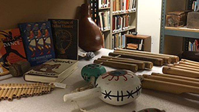 various musical instruments and books about dance from different cultures
