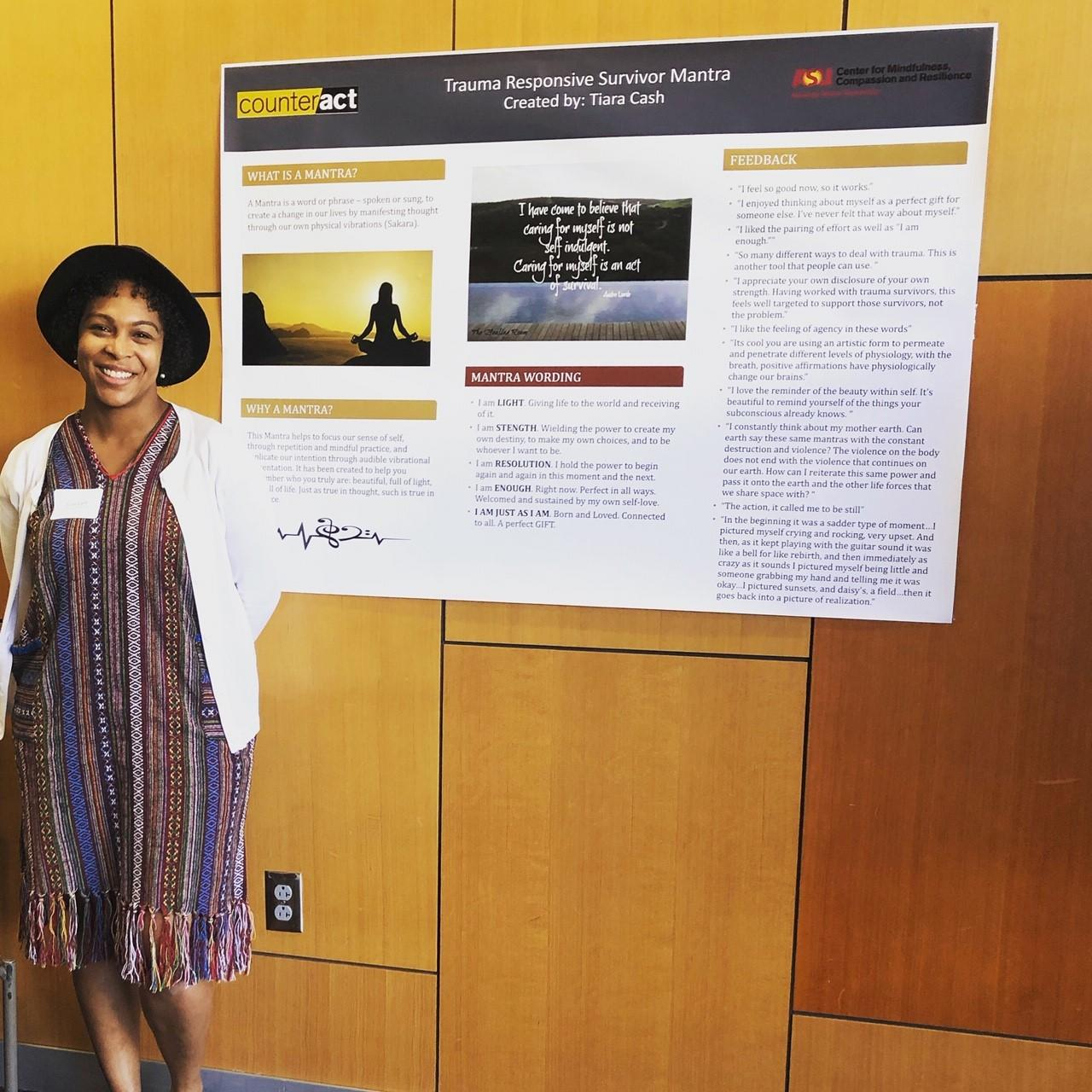 Tiara Cash with a poster of her project